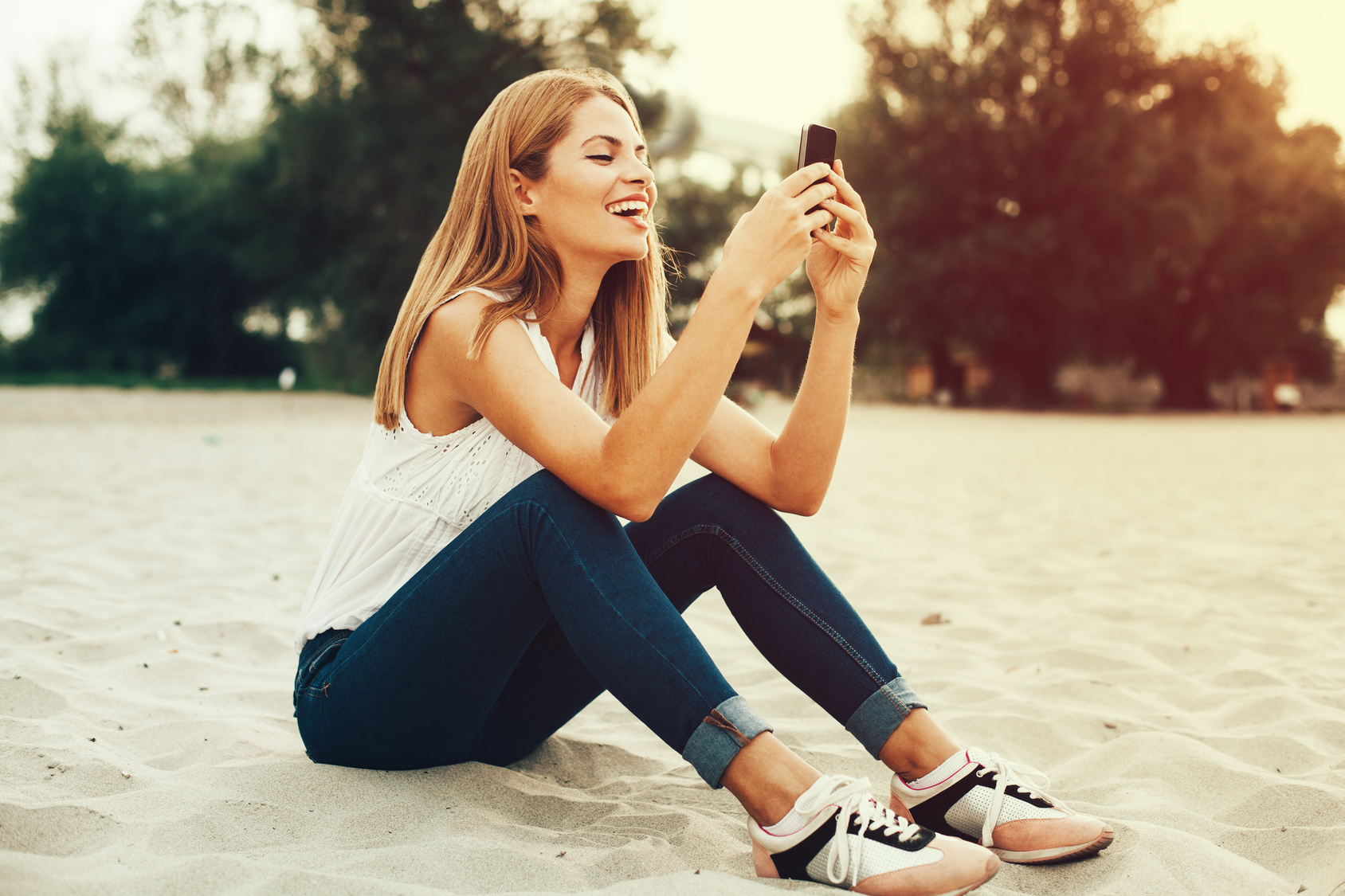 Young woman typing a message on the phone